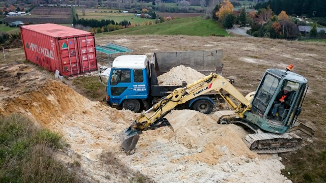 Cutting the hill with a 4-ton digger