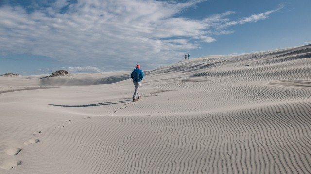 Hiking up a massive sand dune