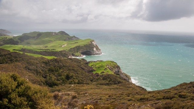 Viewing west from the lighthouse, to the green hills of Wharariki