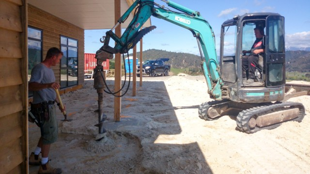Drilling holes for the concrete foundations