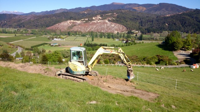 A digger, preparing the terraces for our wastewater disposal area