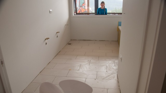 Floor tiles in the kid's bathroom almost finished