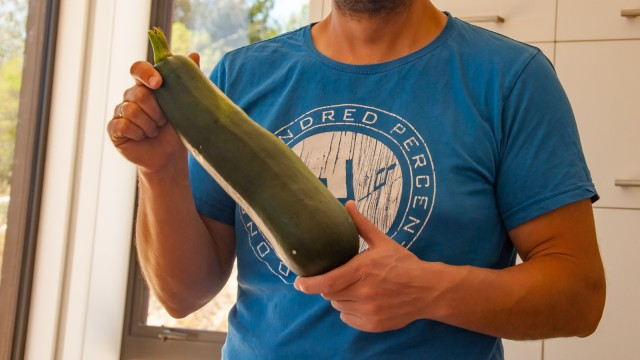 Harvesting the first massive zucchini from our garden