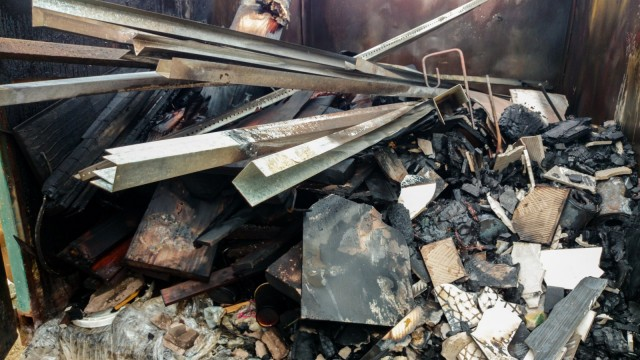 All sorts of timber, metal, and tile cut-offs with plastic makes a good burning mix