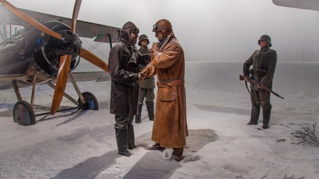 The scenes staged as if it was WWI. Creepy.