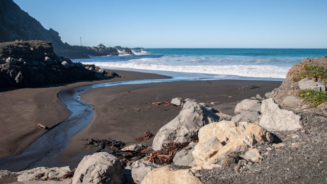 Black sand and big waves.