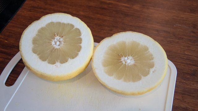 It has the shape of a grapefruit, a thick skin of a pomelo and tastes like a giant lemon. Any ideas what it is?