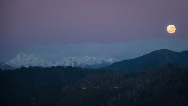 Before dawn full moon over Mt Arthur